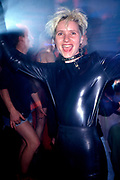 A clubber wearing a rubber suit on the main dancefloor of the Hacienda, Manchester 1988
