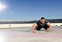 Actor, Laz Alonso, works out for a photo shoot