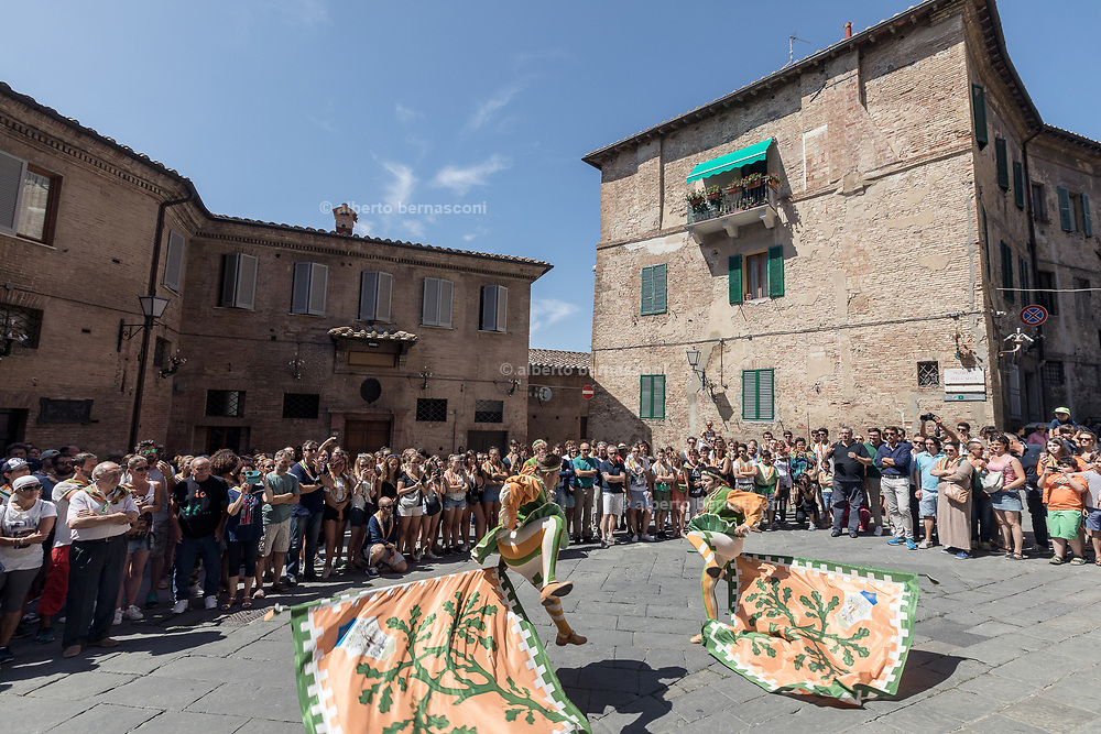 """Italy, Siena, the Palio: Blessing of the horse and the jockey in each Contrada's parish church. The priest ends the mystical rite with a wish that sounds like an order: """"Go and come back victorious!"""" . Selva contrada"""