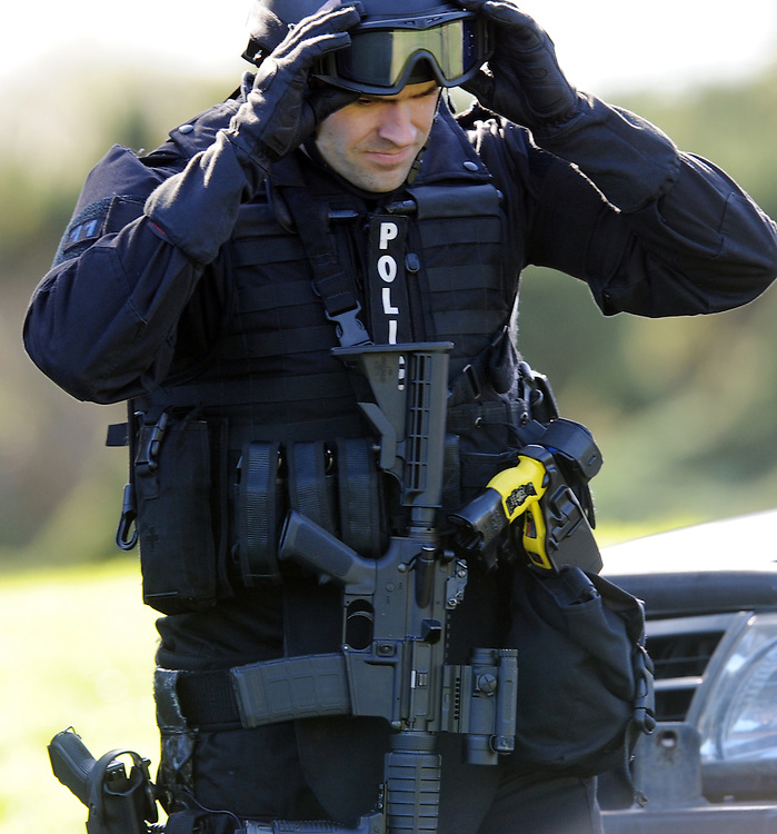 Police AOS (Armed Offenders Squad) take part in a public display to celebrate 50 years of the AOS at the Royal Police College, Porirua, New Zealand, Saturday, August 09, 2014. Credit:SNPA / Ross Setford
