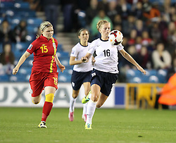 England's Natasha Dowie (Liverpool) controls the ball under pressure from Wales's Michelle Green - Cardiff City Ladies - Photo mandatory by-line: Robin White/JMP - Tel: Mobile: 07966 386802 26/10/2013 - SPORT - FOOTBALL - The Den - Millwall - England Women v Wales Women - World Cup Qualifier - Group 6