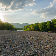 A stony beach along the Saco River in North Conway, NH