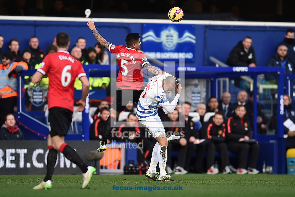 Bobby Zamora of Queens Park Rangers gets hit in the face by Marcos Rojo of Manchester United during the Barclays Premier League match at the Loftus Road Stadium, London<br /> Picture by Andrew Timms/Focus Images Ltd +44 7917 236526<br /> 17/01/2015