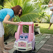 SEPTEMBER 10, 2016----WEST PALM BEACH, FLORIDA<br /> Brenda Hockman, 41, shows standing water on one of her daughter 's in their house's backyard on a Saturday morning. Hockman runs a pest control company and is not afraid to play outdoors even in the face of a mounting Zika virus infection problem in Florida.<br /> (Photo by Angel Valentin/Freelance Photographer)