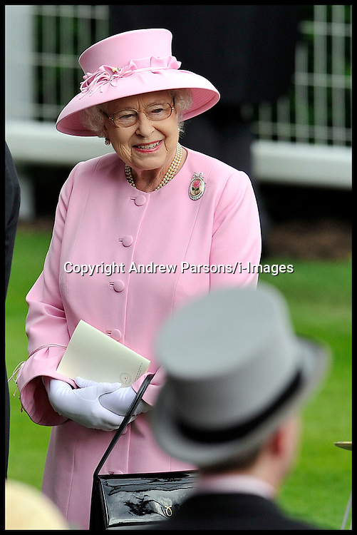 HM The Queen in the Parade Ring before the 3rd Race The 150th Anniversary of the Prince of Wale's Stakes, as she talks to her Trainer Sir Michael Stoute and her jockey Ryan Moore, With her son Prince Edward on Day 2 of  Royal Ascot Day, Wednesday June 20, 2012. Photo by Andrew Parsons