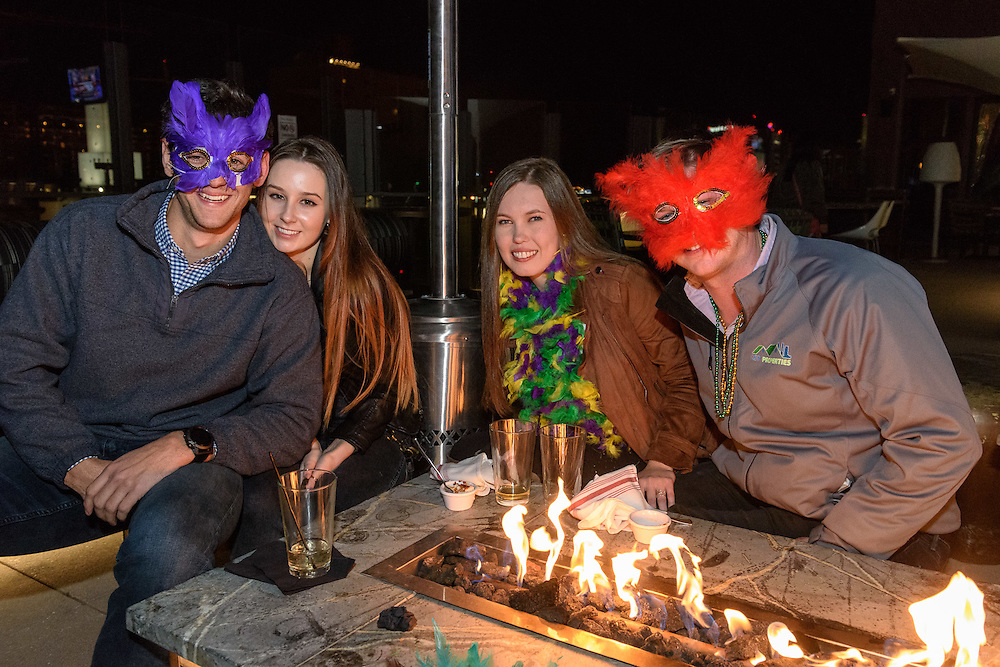 A celebration of Mardi Gras and the birthday's of Joey Wagner, Todd Sharp and Frankie Hilbert, Saturday, Feb. 25, 2017 at 8Up Elevated Drinkery & Kitchen at 350 W Chestnut St., atop the Hilton Garden Inn in downtown Louisville, Ky. (Photo by Brian Bohannon)