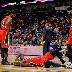 Dec 16, 2018; New Orleans, LA, USA; New Orleans Pelicans forward Anthony Davis (23) and guard E'Twaun Moore (55) looks over injured forward Julius Randle (30) during the second half against the Miami Heat at the Smoothie King Center. Mandatory Credit: Derick E. Hingle-USA TODAY Sports