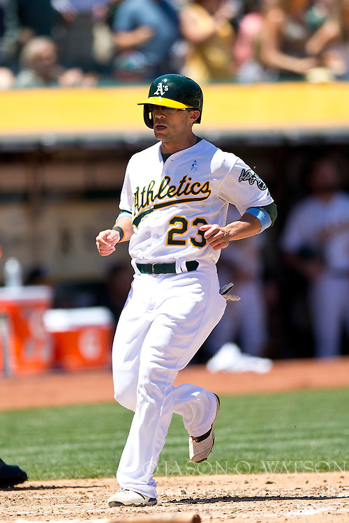OAKLAND, CA - JUNE 21:  Sam Fuld #23 of the Oakland Athletics scores a run on a hit by Billy Burns (not pictured) during the third inning against the Los Angeles Angels of Anaheim at O.co Coliseum on June 21, 2015 in Oakland, California. The Oakland Athletics defeated the Los Angeles Angels of Anaheim 3-2.  (Photo by Jason O. Watson/Getty Images) *** Local Caption *** Sam Fuld