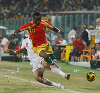 Photo: Steve Bond/Richard Lane Photography.<br /> Guinea v Morocco. Africa Cup of Nations. 24/01/2008. Elamin Erbate (rear) takes the legs of Souleymane Youla (front)