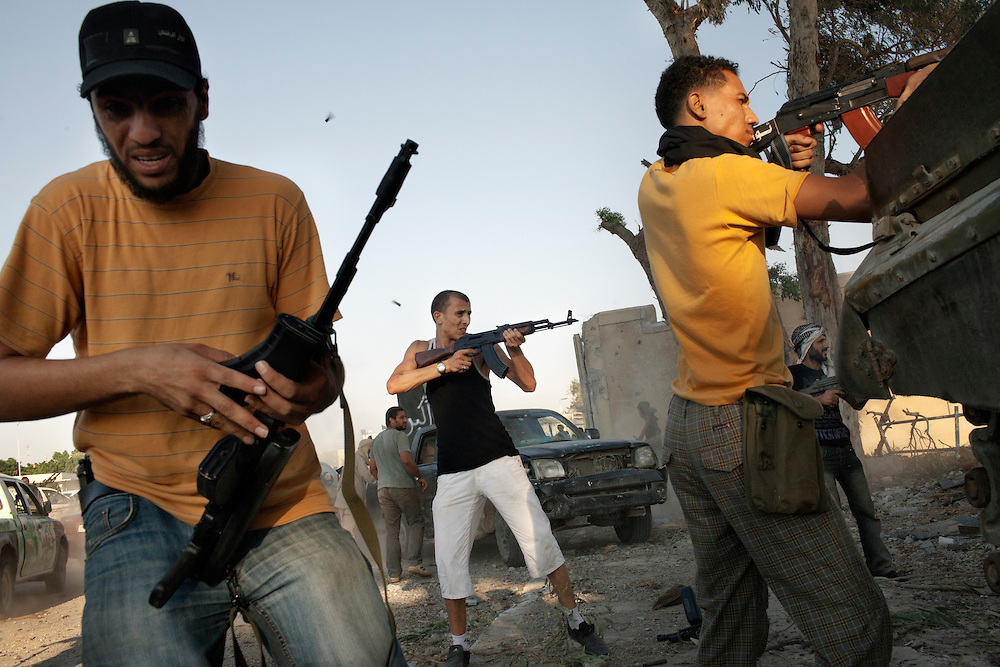 Rebels fight on the frontline during the battle for Bab Al Aziziya, the Gaddafi's walled citadel in center Tripoli..
