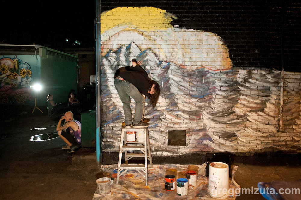Carlos Lee Sullivan works on his mural late in the evening of August 6, 2016 during the Freak Alley Gallery sixth annual mural event in downtown Boise, Idaho.<br /> <br /> Freak Alley Gallery's week long event provided an &quot;art-in-motion&quot; experience as it welcomed the public to watch artists work on their murals.