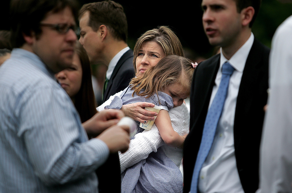 (051709 Cambridge, MA)  Jane Johnson holds her daughter Ella, 4,  as they watch their church, the Jesus Christ Church of Latter-Day Saints on Longfellow Park in Cambridge, burn in a fire that started during Sunday mass.