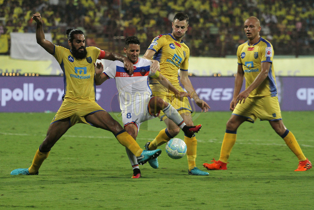 Ferran Corominas Telechea of FC Goa tries to get past the defence of Kerala Blasters FC during match 54 of the Hero Indian Super League between Kerala Blasters FC and FC Goa  held at the Jawaharlal Nehru Stadium,Kochi India on the 21st January 2018<br /> <br /> Photo by: Vipin Pawar  / ISL / SPORTZPICS