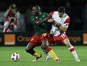 SZCZECIN 11/08/2010.FOOTBALL INTERNATIONAL FRIENDLY.POLAND v CAMEROON.HENRI BIENVENU NSTAMA /CAM/ I MICHAL ZEWLAKOW /POL/.Fot: Piotr Hawalej / WROFOTO
