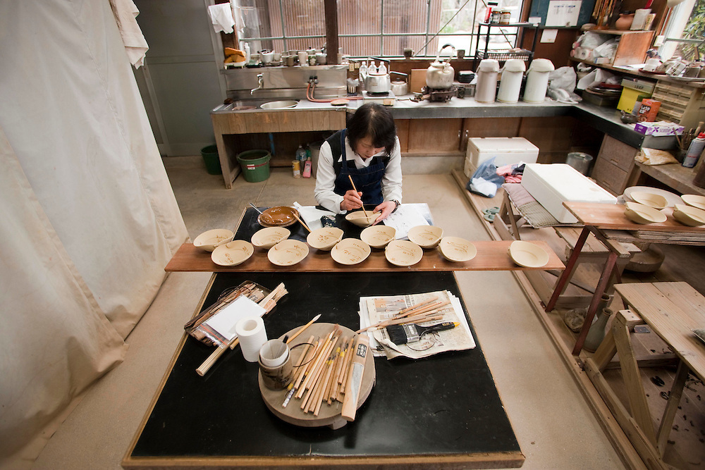 Nakazato Taroemon kiln (3-6-29 Machida, Karatsu; +81-955-72-8171), located a five minute walk from the train station. The 14th successor--in an unbroken lineage--plies his trade here along with a large staff of over twenty. Situated within a Japanese bonsai garden, the time-honoured spot also features a small shop connected to a museum by a simple wooden bridge.production studio