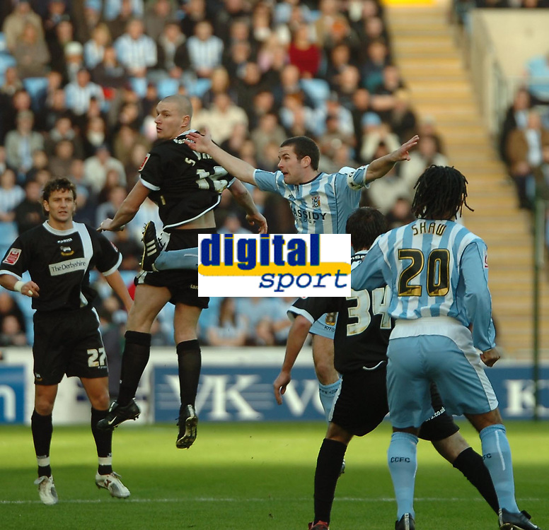 Photo: Ed Godden.<br />Coventry City v Derby County. Coca Cola Championship. 21/01/2006. <br />Derby's Seth Johnson (2nd, L) and Michael Doyle (3rd, R) compete for the ball in the air.