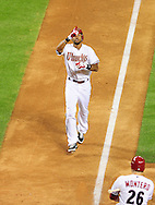 May 19 2011; Phoenix, AZ, USA; Arizona Diamondbacks batter Chris Young (24) reacts at home plate after hitting a one run home run during the sixth inning against the Atlanta Braves at Chase Field. Mandatory Credit: Jennifer Stewart-US PRESSWIRE