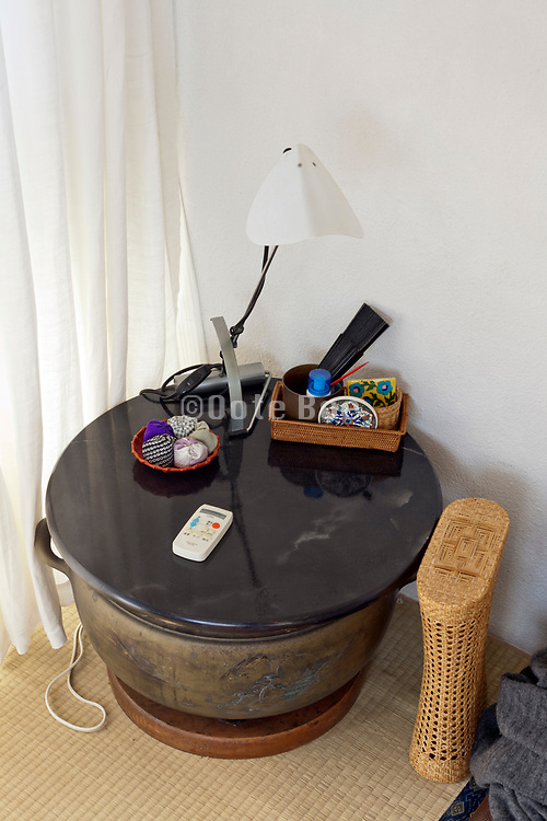 improvised little round table with various objects on it