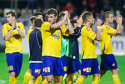 Miha Blazic and other players  of Koper celebrate after winning during football match between FC Luka Koper and NK Maribor in 12th Round of Prva liga Telekom Slovenije 2013/14 on September 28, 2013 in Stadium Bonifika, Koper, Slovenia. (Photo by Vid Ponikvar / Sportida.com)