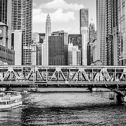 Chicago River panoramma black and white picture of Wells Street Bridge and downtown Chicago city buildings. Panorama photo ratio is 1:3.