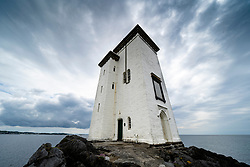 Port Ellen Lighthouse at Carraig Fhada  on Islay in Inner Hebrides, Scotland , UK