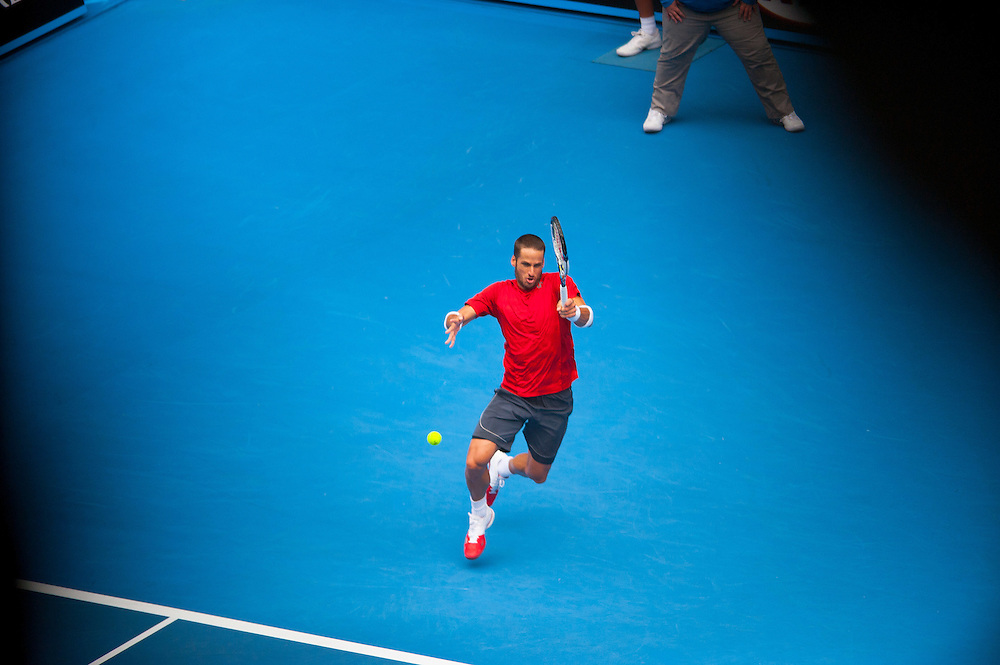 Feliciano Lopez (ESP) faced Andy Murray in Day 6 Men's Singles play at the 2014 Australian open in Melbourne's HiSense Arena. Murray won the match 7 (7) - 6 (2), 6-4, 6-2. The darkening photographic effect was created by shooting through a structural steel grid in the Hisense Arena catwalk.