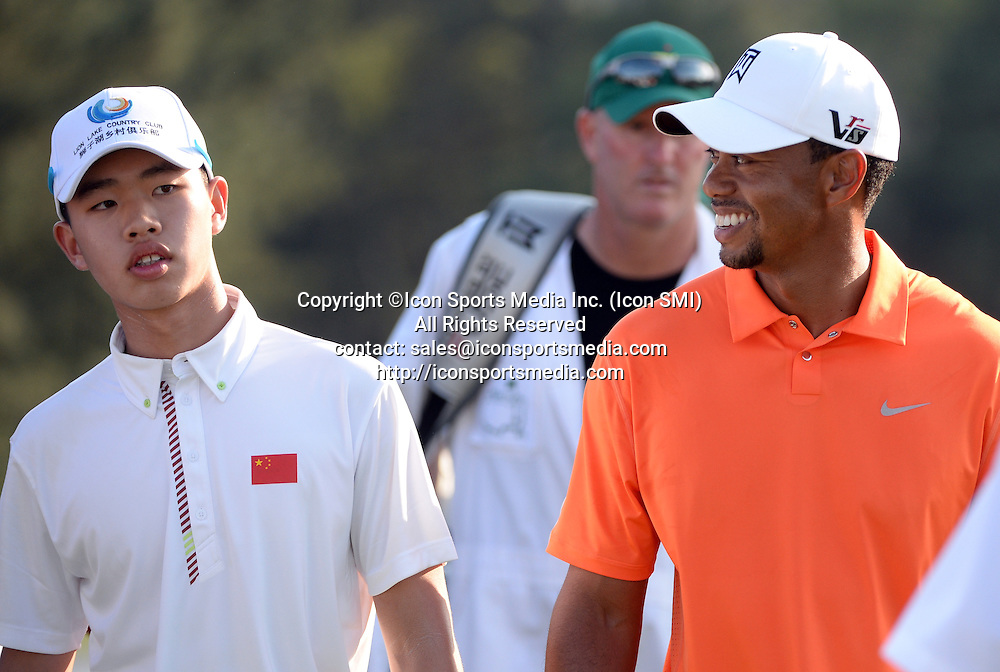 April 8, 2013 - Augusta, Georgia, U.S. - TIGER WOODS (R) and TIANLANG GUAN walk off the 18th green during the first practice round of the 2013 Masters Tournament at Augusta National Golf Club
