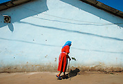 street scene with old woman in Oltenia, south-east of Romania