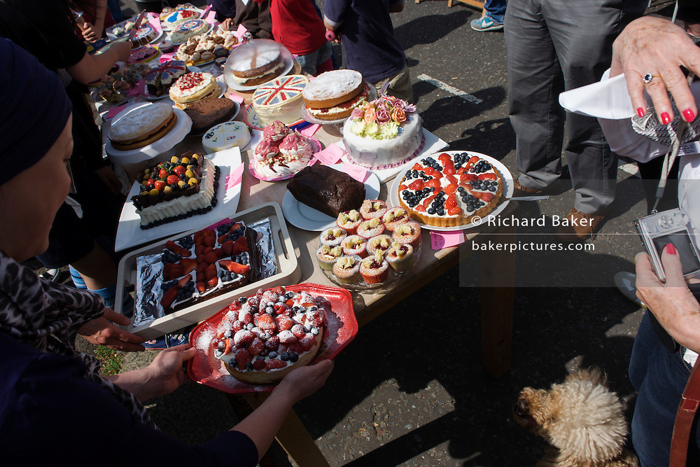 Home-made cakes compete in a competition at a neighbourhood street party in Herne Hill, south London celebrating the Diamond Jubilee of Queen Elizabeth. A few months before the Olympics come to London, a multi-cultural UK is gearing up for a weekend and summer of pomp and patriotic fervour as their monarch celebrates 60 years on the throne and across Britain, flags and Union Jack bunting adorn towns and villages.