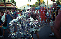 Man covered in small mirrors in the Fantasy fest Captain Morgan parade on the streets of Key West.