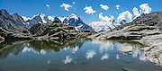 """Tschierva Glacier flows from the peaks clustered on left: Piz Bernina (4049 m), Piz Scerscen (3971 m) and Piz Roseg (3937 m). At right (west), Roseg Glacier flows from Piz Glüschaint (3594 m). Hike from Pontresina up Roseg Valley to Fuorcla Surlej for stunning views of Piz Bernina and Piz Rosegg, finishing at Corvatsch Mittelstation Murtel lift. Walking 14 km, we went up 1100 meters and down 150 m. Optionally shorten the hike to an easy 4 km via round trip lift. Pontresina is in Upper Engadine, in Graubünden (Grisons) canton, Switzerland, the Alps, Europe. The Swiss valley of Engadine translates as the """"garden of the En (or Inn) River"""" (Engadin in German, Engiadina in Romansh, Engadina in Italian). This image was stitched from multiple overlapping photos."""