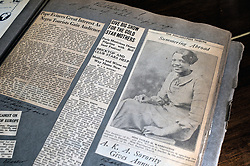 Wesley Enhanced Living at Stapeley, Germantown, Philadelphia, PA USA - March 8 2012; Newspaper clippings from the 1930's include a report of audience with Pope Leo in the Vatican and a portrait of the young Miss Violet in the Philadelphia Tribune.