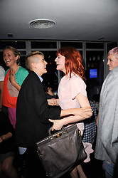 Left to right, AGYNESS DEYN and FLORENCE WELCH at the W Hotels & American Express launch for the James Small collection at Number One Leicester Square, London on 22nd September 2010.