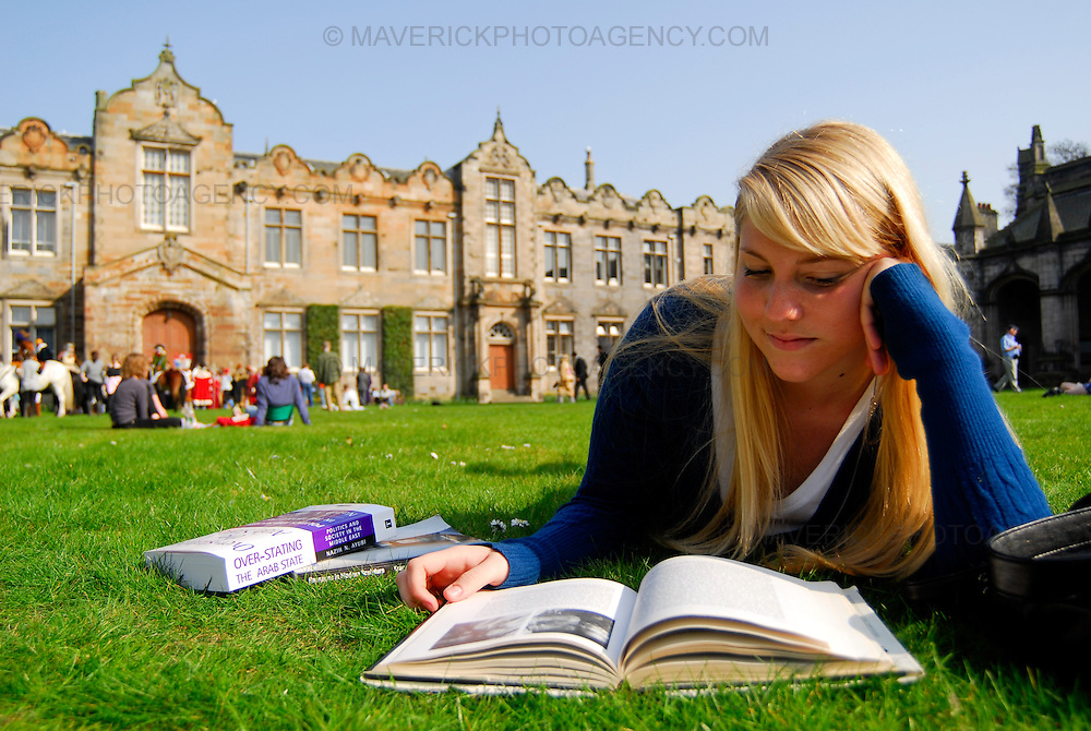 An American student studies on the lawn outside St Andrews University.