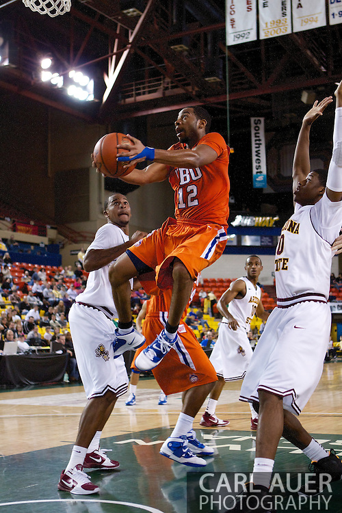 November 25th, 2010:  Anchorage, Alaska - Houston Baptist guard Michael Moss (12) attempts a lay up in the Huskies loss to the Arizona State Sun Devils 73-55 in their first round game of the Great Alaska Shootout.