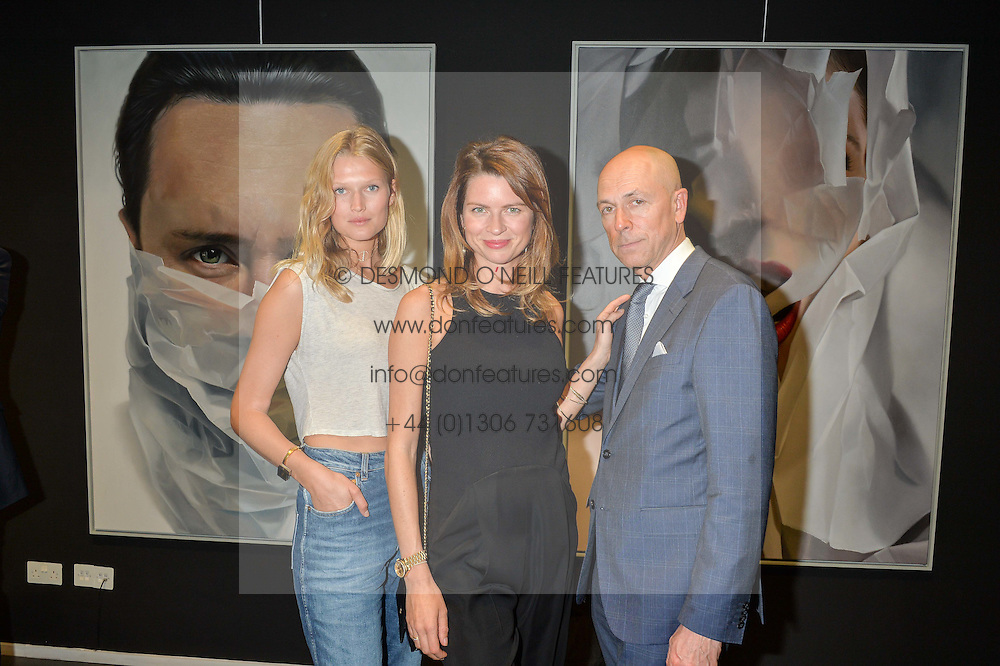 Left to right, model TONI GARRN, GABRIELA PEACOCK and DYLAN JONES at a private view of woks by German artist Mike Dargas held at the Opera Gallery, 134 New Bond Street, London on 5th July 2016.