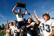 110610-Conifer, COLORADO-mountainbowl-Evergreen High School's Kevin Cassell (No. 88) is carried by teammates holding the Mountain Bowl trophy after defeating Conifer Saturday, November 6, 2010 at Conifer HIgh School. The Cougars defeated the Lobos in the last minute of the Mountain Bowl, making the final score, 17-13..Photo By Matthew Jonas/Evergreen Newspapers/Photo Editor