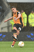 Hull City midfielder Jake Livermore (14)  during the Sky Bet Championship match between Hull City and Leeds United at the KC Stadium, Kingston upon Hull, England on 23 April 2016. Photo by Ian Lyall.