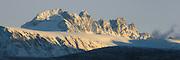 Montain with golden sunlight and snow. Blue clear sky | Fjell med gyllent sollys og snø. Blå klar himmel.