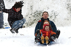 © Licensed to London News Pictures.  05/02/2011.ELY, UK. Liz Morris (back right), Will Morris, 5, (middle right) and Ben Manning, 4 (front right) narrowly avoid crashing  while sledging in Cherry Hill Park, Ely after a heavy (15cm+) overnight snowfall. *** Verbal permission obtained from parents of the named children.***  Photo credit :  Cliff Hide/LNP