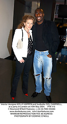 Interior designer KELLY HOPPEN and footballer SOL CAMPBELL, at a party in London on 10th May 2004.PTX 115