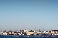 Taranto, Italia - 28 luglio 2012. Una vedita di Taranto. Sullo sfondo le ciminiere dello stabilimento ILVA..Ph. Roberto Salomone Ag. Controluce.ITALY - A view of the city of Taranto in southern Italy on July 28, 2012. In the background the comneys of the ILVA plant.