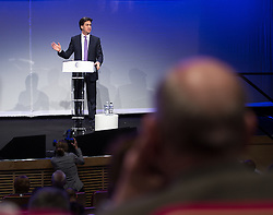 © Licensed to London News Pictures . 28/03/2014 . Manchester , UK . ED MILIBAND , the leader of the Labour Party , addresses an audience at the Federation of Small Businesses at Manchester Central Exhibition Centre today (Friday 28th March 2014). Photo credit : Joel Goodman/LNP
