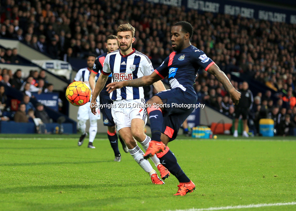 28th December 2015 - Barclays Premier League - West Bromwich Albion v Newcastle United - Georginio Wijnaldum of Newcastle United clears as James Morrison of West Bromwich Albion closes in - Photo: Paul Roberts / Offside.