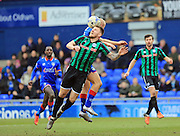 Ashley Eastham wins a header during the Sky Bet League 1 match between Oldham Athletic and Rochdale at Boundary Park, Oldham, England on 19 March 2016. Photo by Daniel Youngs.