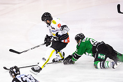 22.02.2015, Hala Tivoli, Ljubljana, SLO, EBEL, HDD Telemach Olimpija Ljubljana vs Dornbirner EC, 6. Qualification Round, in picture Guillaume Desbiens (Dornbirner EC, #41) vs Maks Selan (HDD Telemach Olimpija, #44) during the Erste Bank Icehockey League 6. Qualification Round between HDD Telemach Olimpija Ljubljana and Dornbirner EC at the Hala Tivoli, Ljubljana, Slovenia on 2015/02/22. Photo by Matic Klansek Velej / Sportida