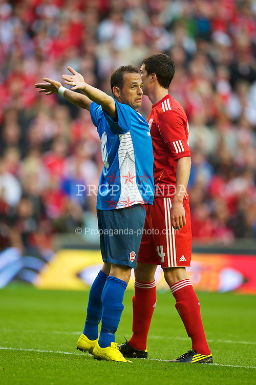 LIVERPOOL, ENGLAND - Thursday, August 5, 2010: Liverpool's Martin Kelly and FK Rabotnicki's Ze Carlos during the UEFA Europa League match at Anfield. (Photo by David Rawcliffe/Propaganda)
