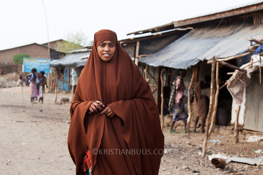 In Dowe. Helema sits on the community council with Sultaan and is head of Women and Children's office in Dowe. She is unmarried. She works with AISDA advocating stopping FGM. Being a woman in Afar Helema knows all about the consequences FGM has on girls and women.   Action for Integrated Sustainable Development Association (AISDA) work in the AFAR region of Eastern Ethiopia, based in Delafagi. The Afars practise an old tradition of Female Genital Mutilation where the baby girls has her clitoris and labia cut away and her vagina sewn up. The day before her wedding day the girl is un-stiched ready for marriage. Its a brutal and barbaric tradition which AISDA is challenging with great effect, now more than a hundred girls in Dowe district have been saved from the knife and AISDA is now rolling out the scheme in Delafagi. Delafagi is where the oldest ever human remains have been found, the found is thought to be 4.5 mill years old.