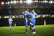 Kazenga LuaLua celebrates in his usual style after scoring Brighton's second goal  during the Sky Bet Championship match between Brighton and Hove Albion and Derby County at the American Express Community Stadium, Brighton and Hove, England on 3 March 2015. Photo by Geoff Penn.