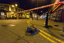 © Licensed to London News Pictures. 26/10/2016. LONDON, UK.  A jacket lay on the floor within the first police cordon around East Street near Barking Supermarket in Barking, east London. Police were called at 18:12 on Wednesday 26th October. Officers and the London Ambulance Service attended the scene and found a man in his late 20s with stab wounds to the abdomen. He was taken to an east London hospital where he remains with life threatening injuries.  Photo credit: Vickie Flores/LNP